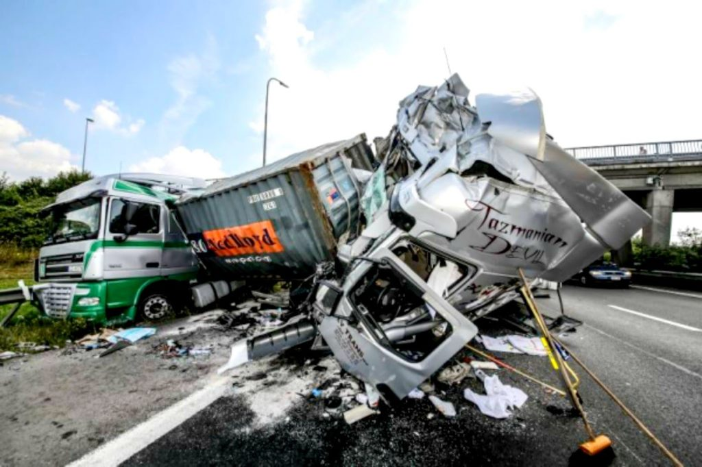 Two trucks badly crashed on a highway