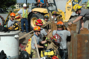 Image of construction workers and firemen after accident